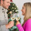 Happy couple enjoying some wine — Stock Photo #56912223