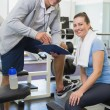 Personal trainer and client looking at clipboard together — Stock Photo #56913285