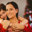Festive mother and daughter smiling at each other — Stock Photo #56913837