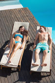 Couple resting on sun loungers — Stock Photo