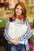 Smiling girl holding some vinyls — Stock Photo