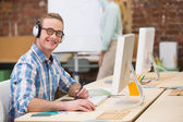 Casual male photo editor using digitizer in office — Stock Photo