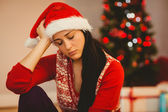 Festive brunette feeling sad at christmas — Stock Photo