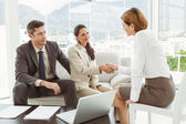 Couple in meeting with financial adviser at home — Stock Photo