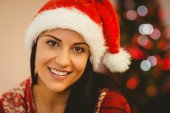 Festive brunette smiling at camera — Stock Photo
