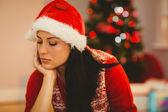 Festive brunette feeling sad at christmas — Stock Photo