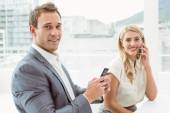 Business people using mobile phones — Stock Photo