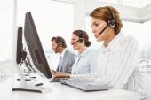 Business people with headsets using computers in office — 图库照片