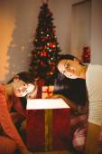 Festive mother and daughter opening a glowing christmas gift — Stock Photo