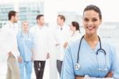 Portrait of a smiling confident female doctor — Stock Photo