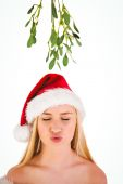 Festive cute blonde under mistletoe — Stock Photo