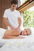 Woman receiving back massage — Stock Photo