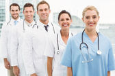 Portrait of confident doctors in row — Stock Photo