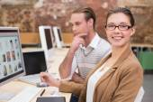 Smiling photo editors using computers in office — Stock Photo