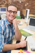 Male photo editor using digitizer in office — Stock Photo