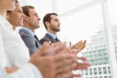 Business people clapping hands in office — Stock Photo