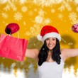 Composite image of woman wearing red boxing gloves — Stock Photo #57148815