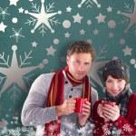 Composite image of couple both having warm drinks — Stock Photo #57149079
