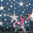 Composite image of man pushing woman in trolley — Stock Photo #57149437