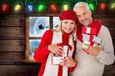 Happy festive couple with gifts — Foto de Stock