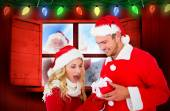 Composite image of young festive couple — Stock Photo
