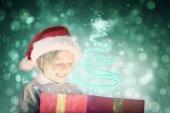 Festive boy opening gift — Stock Photo