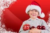 Imagem composta de festivo menino sorrindo — Fotografia Stock