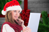 Festive blonde looking at tablet pc — Foto de Stock