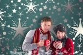 Composite image of couple both having warm drinks — Stock Photo