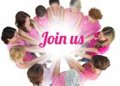 Cheerful women joined in a circle wearing pink for breast cancer — Stock Photo