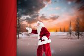 Composite image of santa pulls something with a rope — Fotografia Stock