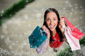 Composite image of woman standing with shopping bags — Fotografia Stock