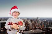 Composite image of festive boy smiling — Stock Photo