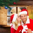 Composite image of young festive couple — Stock Photo #57150303