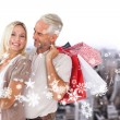 Happy couple with shopping bags and tablet pc — Stock Photo #57150513