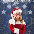 Composite image of sexy santa girl wearing spectacles — Stock Photo #57150795