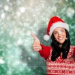 Composite image of woman giving a thumbs up — Stock Photo #57151379