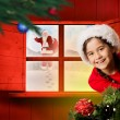 Festive girl looking from behind christmas tree — Stock Photo #57151467