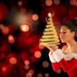 Santa girl blowing over her hands — Stock Photo #57151661
