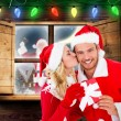 Composite image of young festive couple — Stock Photo #57151729