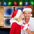 Composite image of young festive couple — Stock Photo #57153999