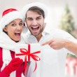 Festive young couple holding gift — Stock Photo #57154349