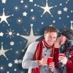 Composite image of couple both having warm drinks — Stock Photo #57154375