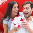 Composite image of woman surprising boyfriend with gift — Stock Photo #57154709