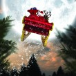 Composite image of santa flying his sleigh — Stock Photo #57155025