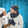 Composite image of young winter couple — Stock Photo #57155065