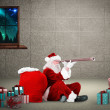 Composite image of santa looking through a telescope — Stock Photo #57155513