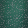 Snowflake pattern against green vignette — Stock Photo #57155605