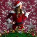 σύνθετη εικόνα της όμορφο κορίτσι στο santa κοστούμι, κρατώντας το χέρι — Φωτογραφία Αρχείου #57155693