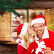 Composite image of young festive couple — Stock Photo #57156501